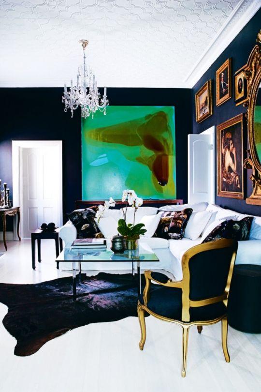 Solid black cowhide in dark living room.