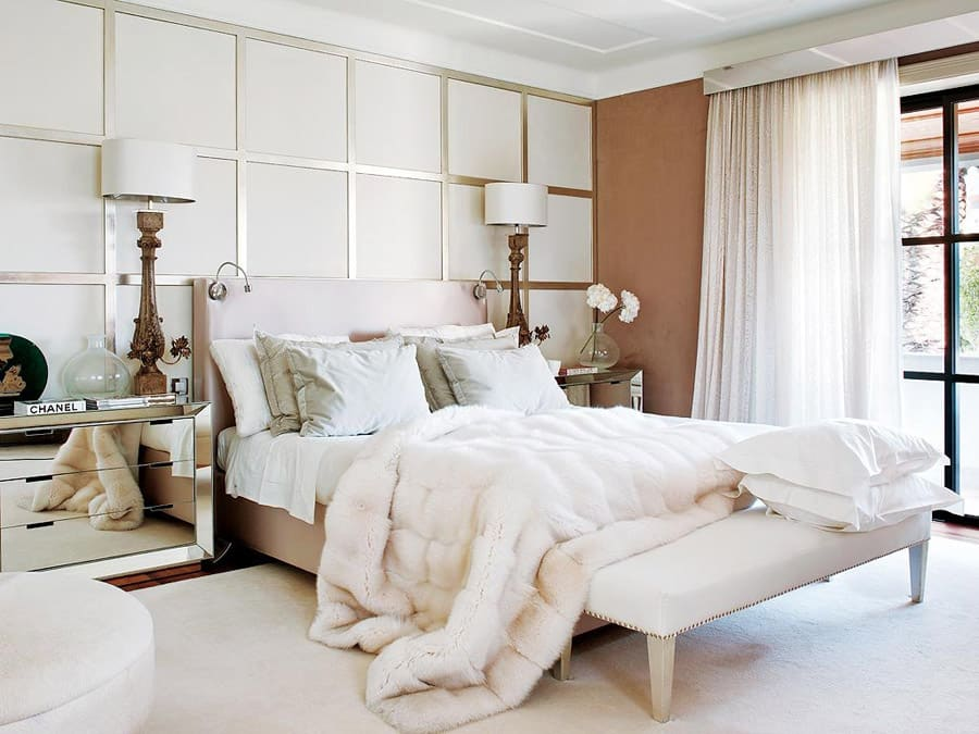 Light toned bedroom with fur blanket