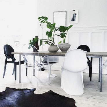 Minimal dining room with cowhide