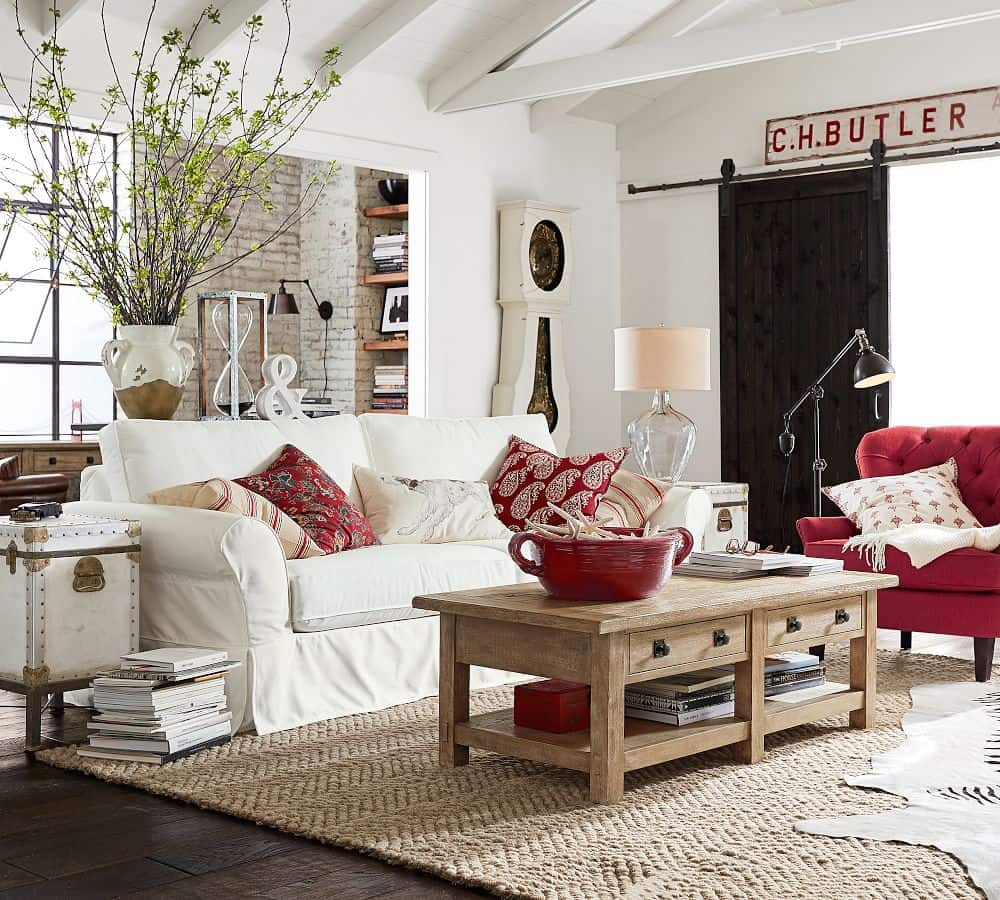 Living room with stacked rugs, top one is cowhide