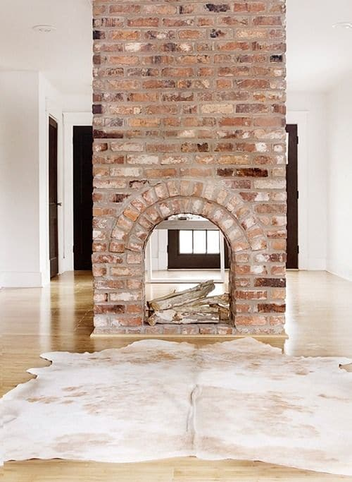 Fireplace with a cowhide in front