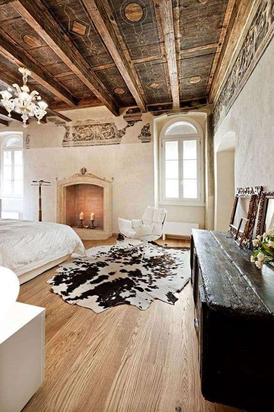 Traditional style bedroom with natural cowhide area rug