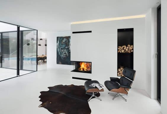 Dark natural cowhide contrasts white room