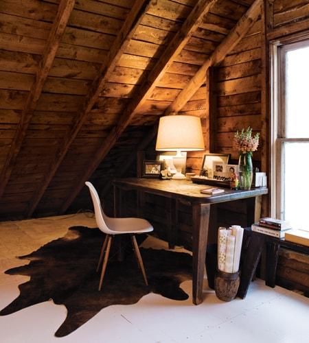 Dark wooden office and dark cowhide rug