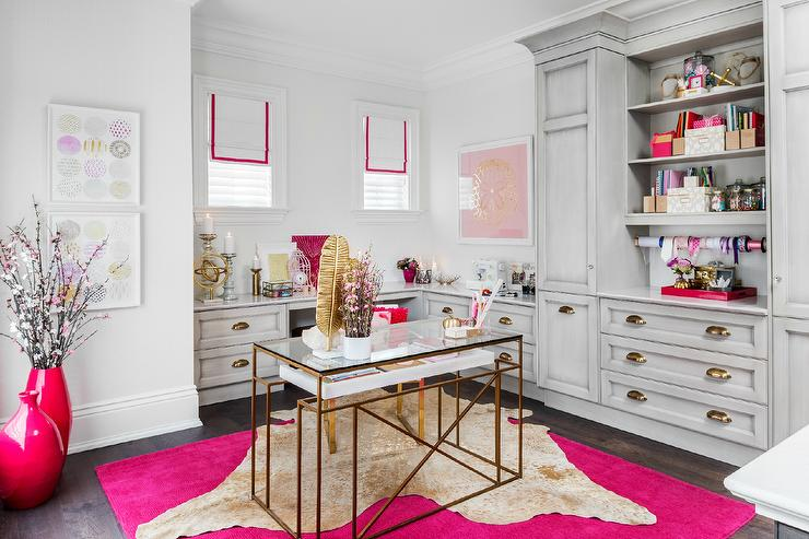 Pink home office with white rug-on-rug cowhide