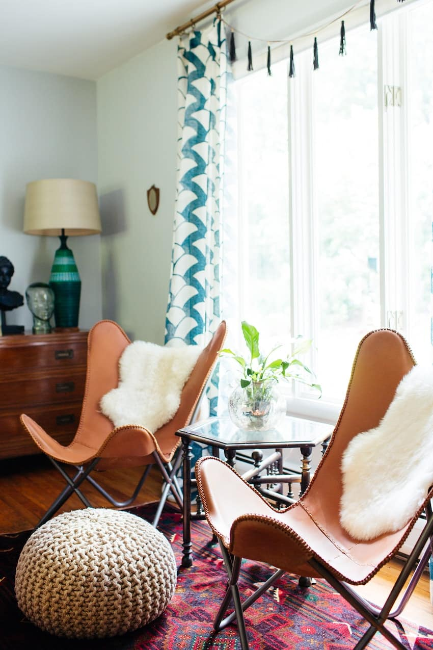 Pair of leather chairs and sheepskin