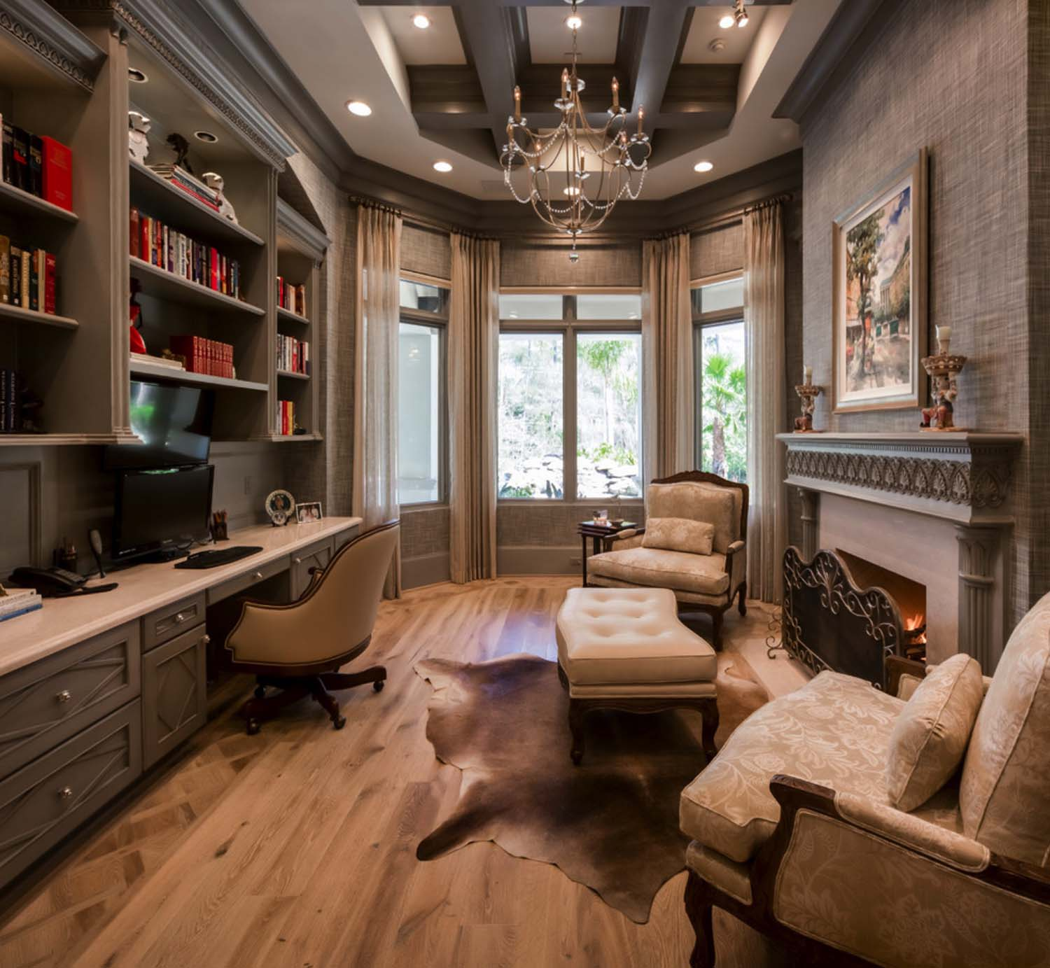 Mid century home office with elegant cowhide before the hearth