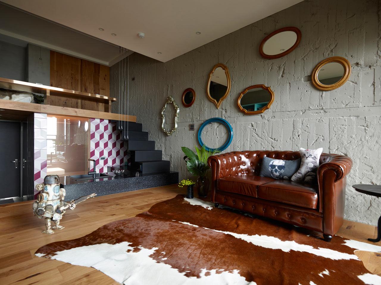 Industrial living room with bovine cowhide