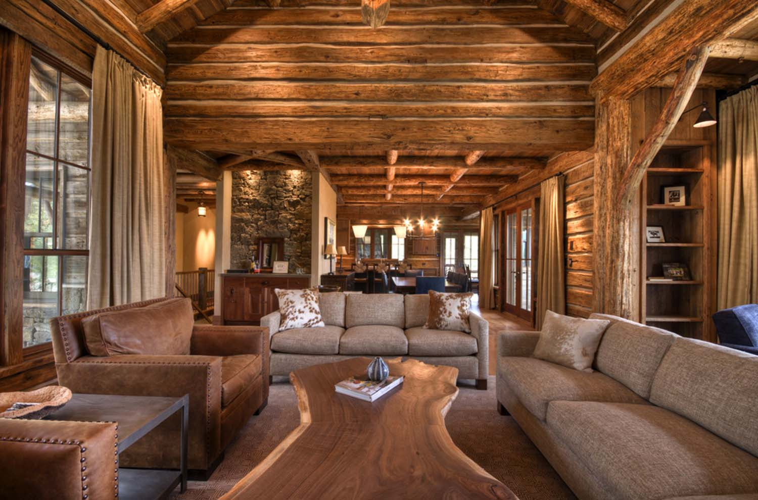 Rustic cabin living room with cowhide cushion on sofas