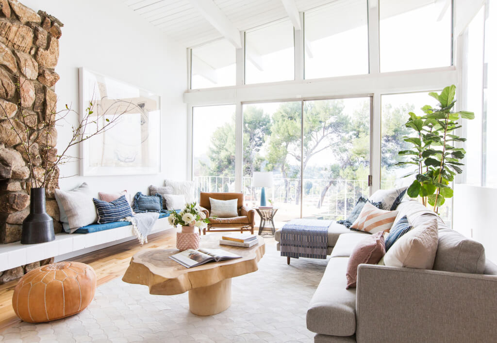 Patchwork cowhide rug in bright light living room