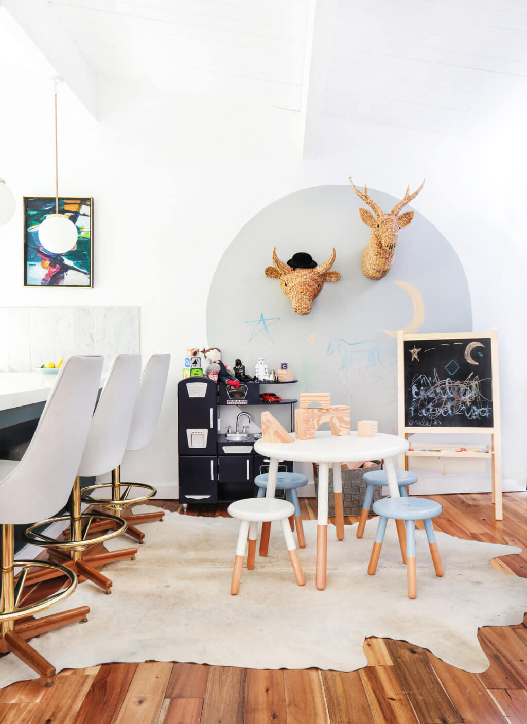 Cowhide rug under kids table, durable and easy to clean