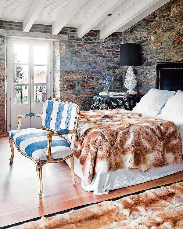 The warmest bedroom with fur rugs and fur blankets