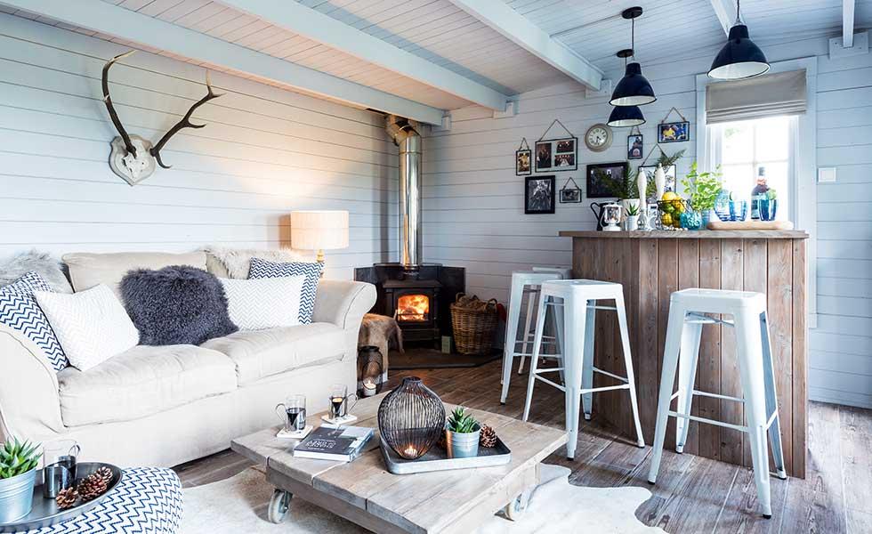 photo of cowhide rug furry cushions cozy room
