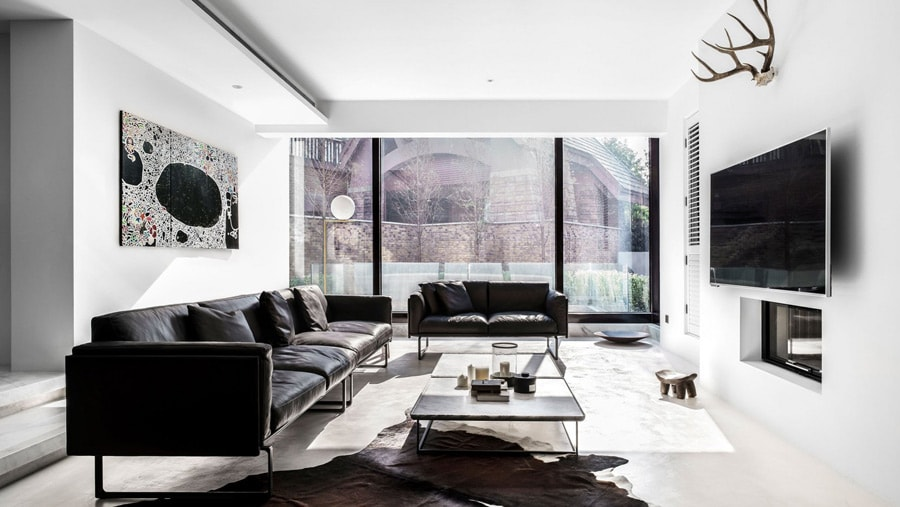 Photo of natural cowhide in white living room