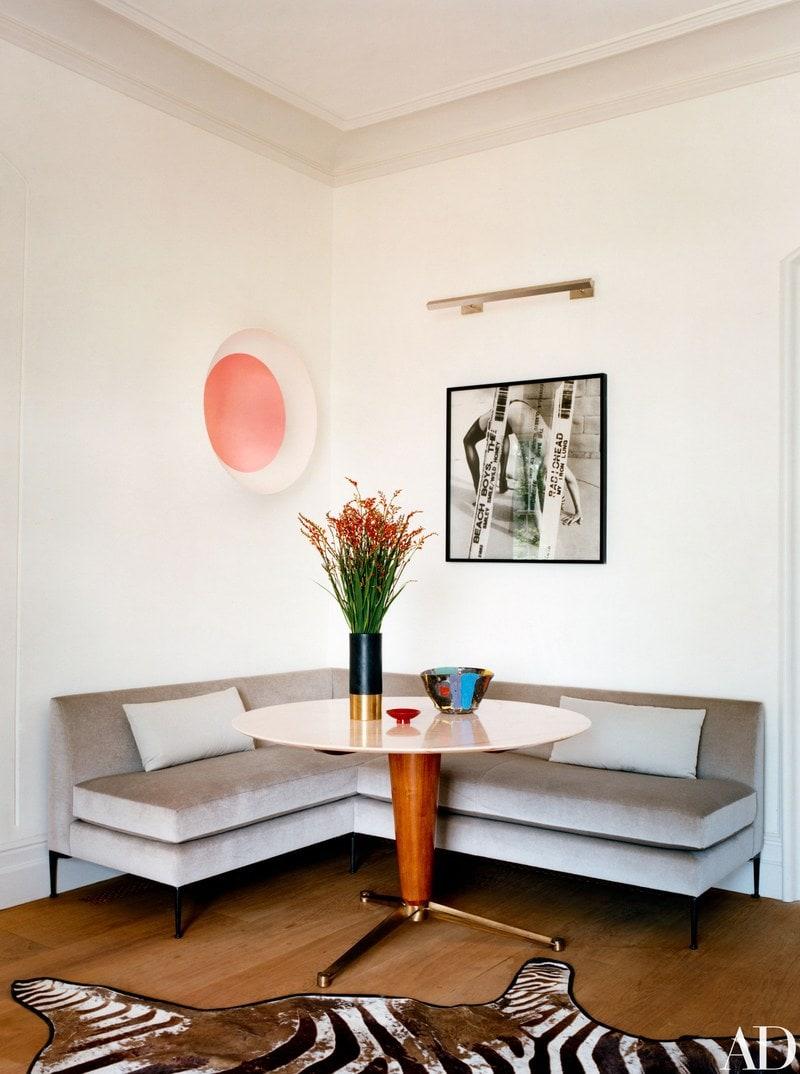 Photo of animal print zebra rug in front of corner sofa