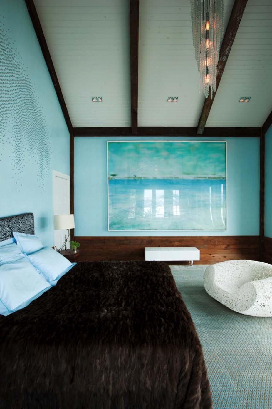 Brown fur blanket blue bedroom