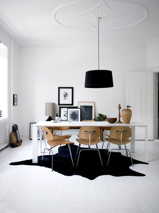 Natural black cowhide under table dining room