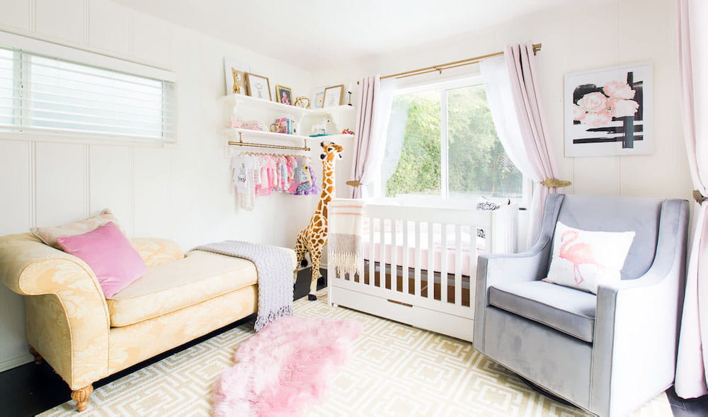 Pink animal shaped sheepskin rug in nursery.