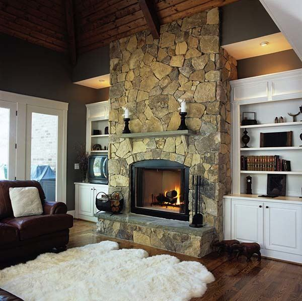 Large sheepskin carpet in front of fireplace.