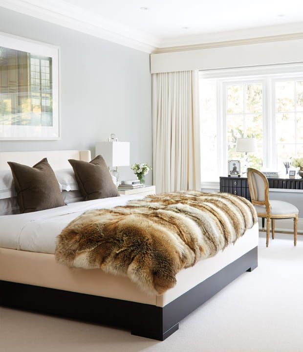 Gold fur bedcover neatly made.