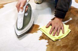 how to clean cowhide rug