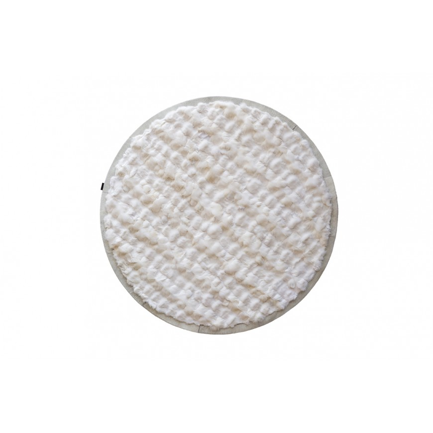 Round fur rug from white arctic fox with cowhide frame