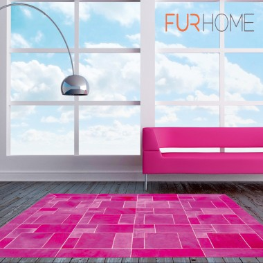 Leather area rug fuxia puzzle frame along pink couch